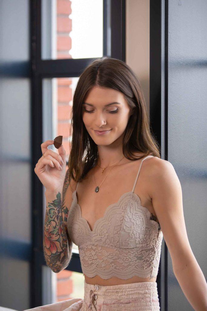 Woman microdosing cannabis edible for anxiety