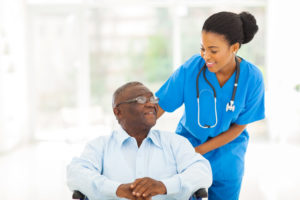 A shot of a black nurse caring for a senior patient in a wheelchair. Cannabis use among older adults is quickly growing in popularity.