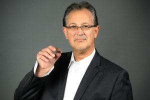 A shot of Rick Scarpello, Medically Correct CEO and Co-Founder, posed with a piece of Nove cannabis luxury chocolates.