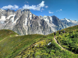 A group of three athletes running in Courmayer, Italian Alps.